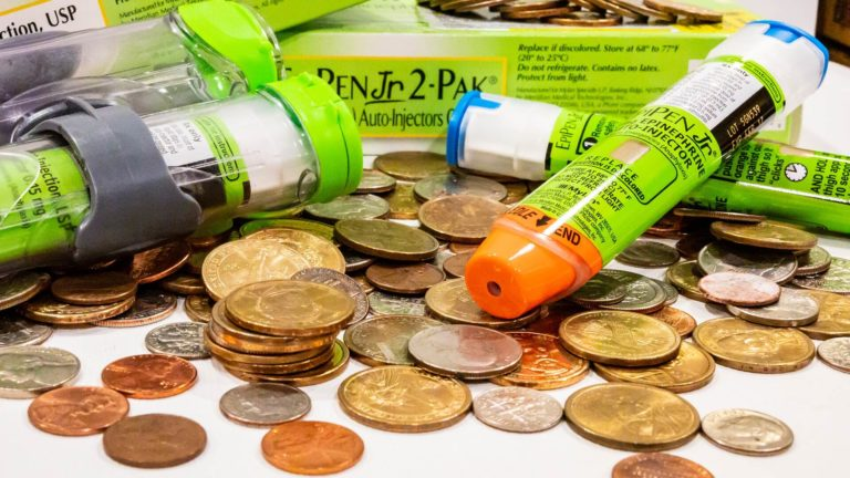 EpiPen Injectors among coins